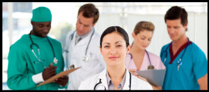 female MD semi-smiling in front of other medical people in conversations 473x210